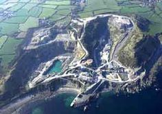 Dean Quarry, St Keverne. A large quarry on the Lizard coast where greenstone is still quarried for use as roadstone. Photo © Cornwall County Council Historic Environment Service