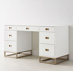 RH TEEN's Avalon Storage Desk:The sleek lines of our collection exemplify the sophisticated restraint of modernism, while its polished cast-brass fittings – including recessed pulls and a metal base – take the composition in a stunning new direction.