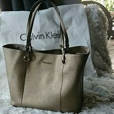 "Large Calvin Klein purse Like new! Only used once or twice I prefer smaller purses.  If your into big purses you will love this!  Has a neutral gold tone to it,  will go with any outfit.  Size aprox 12""Height 14-1/2 Wide,  and 7""depth measured from bottom.  Comes with white dust bag as seen in pic. Calvin Klein Bags Totes"
