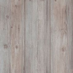 A very realistic rendering of weathered wooden panels. Greyed wood has almost a white wash effect and looks convincingly real in this wallpaper
