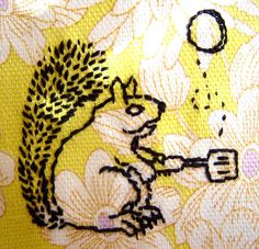 Flapjack squirrel, a freehand embroidered image I made on printed floral cotton vintage fabric