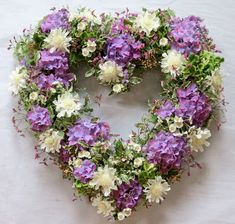 A loose heart wreath. Purple is a traditionally religious colour.