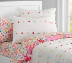 Bright Pom Pom Quilted Bedding, love the white pom pom blanket for her new bed
