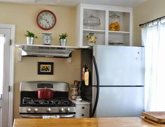 Fridge next to stove use space between as room for a vase for I kitchens and renovations walsall