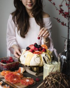 Winter Pavlova with Meyer Lemon Curd, Blood Oranges and Berries |  a stunning gluten-free and dairy-free dessert that's sure to impress.
