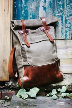 Wolf Hill Adventure Backpack | Free People Handmade in Colorado, this ultra-rugged backpack features a waxed canvas body and English bridle leather straps.