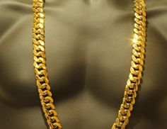 SOLID HEAVY 14K YELLOW GOLD 18mm XXXL THICK MIAMI CUBAN CURB LINK NECKLACE CHAINExtra Thick Cuban NecklaceMake :Designer Link ChainModel :Designer Custom NecklaceWeight :500 + gramsMaterial :14k Gold Finish Over Sterling Silver Dimensions :Width: 18 mm Length: 38 Inches