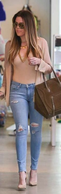Khloe Kardashian: Shirt – Only Hearts  Necklace – Chanel  Sunglasses – Saint Laurent  Purse – Celine  Shoes – Jimmy Choo