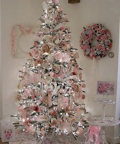 Victorian Christmas Tree ♥ Inspiration for my shabby chic tree. I'm using white fur now, but I'd love to find this gorgeous pink tree skirt!