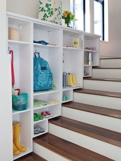 California Closets Stairway Storage - clever use of space to create a drop zone!