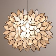 Handcrafted by skilled artisans in the Philippines, our Large Capiz Lotus Hanging Pendant Lantern features white capiz seashells formed into a gorgeous flower ball. The hand-collected natural capiz sh