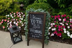 ivy covered chalkboard welcome sign by large lantern