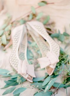 elegant blush pink pearl bridal shoes with bows