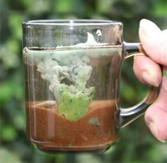 """A volcano in a mug.  Neat idea to show kids how they work.  Much more accurate than the old baking soda/vinegar idea."""
