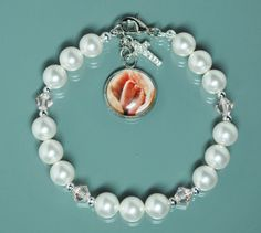 18-Inch Rhodium Plated Necklace with 4mm Faux-Pearl Beads and Sterling Silver Saint Elizabeth of Hungary Charm.