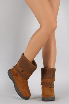 Description These warm flat boots feature a faux suede upper with fold over sweater design, wrapped around strap with buckle accents, and rounded toe. Finished with cushioned insole, soft faux fur int