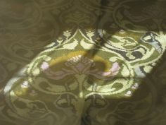 """The sun shining onto the Art Nouveau floral motif of this carpet is what caught my eye as I stood on the front terrace of the Art Nouveau villa, """"Billilla"""" in the Melbourne suburb of Brighton.   The golden yellow and the mauve stood out so beautifully.   I cannot vouch for its authenticity, but considering that Billilla belonged to the wealthy Weatherly family, the carpet may have come from Liberty in London and could be a William Morris design."""