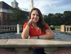 New Bern resident Sara Ferebee poses at Campbell University wearing one of her 'Hooked on a Cure' bracelets.