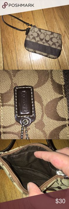 Coach Wristlet Hardly Used Coach Brown Wristlet. As you can see it's very clean inside and out! Give me an offer, I'm negotiable! Coach Bags Clutches & Wristlets