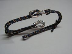 Rock Climbing Bracelet with Climbing Carabiner and Figure Eight made from Sterling Silver with 2 mm Cord  Made by a climber  The climbing carabiner is fully functional, like the real one!   ***** 6$ shipping rate for any destination *****   Measure: - Carabiner: 1.8 cm x 1.2 cm or 0.71 inch x 0.47 inch. - Figure Eight: 2.3 cm x 1.2 cm or 0.9 inch x 0.5 inch    In order to see how the carabiner works you can watch this video: http://www.youtube.com/watch?v=N0l4VsZPfRk Or yo...
