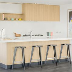 The hint of pastels in this kitchen is the perfect compliment to the black and timber accents. #SignatureHomes Geelong Display. #Weeklyhometrends #home #kitchen #pastals #stools #home #inspire #Caroma #Clark #Dorf