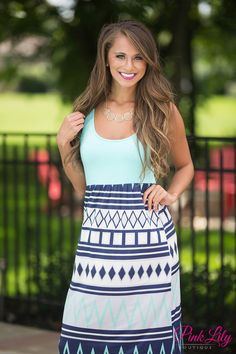 """We love this adorable maxi - it's super versatile and easy to wear for many occasions! It features a gorgeous print on the skirt in mint, navy, light grey and off white. Paired with a mint scoopneck bodice and 2"""" straps, it's comfortable to wear as well."""