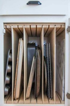 BIG Tip of the Day! Add some slotted wood and some vertical wood sliders to a cabinet to store all those baking sheets/pans!