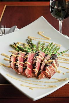 Sliced tenderloin with grilled asparagus and Dijon mustard-and-horseradish aioli at Towson Tavern | Baltimore magazine Photo by Vince Lupo
