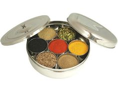 Most Indian homes have at least 1 Masala Dabba, used to store the most commonly used spices such as green cardamom pods, garam masala, fenugreek, mustard seeds, cumin seeds, turmeric, whole cloves, peppercorns, asafoetida, bay leaves, and ground chiles to name a few.