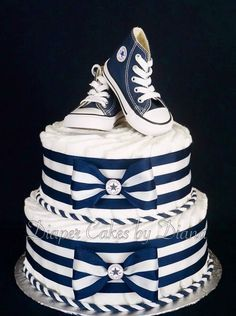 Boy's Diaper Cake Topped with a Pair of Converse Running Shoes www.facebook.com/DiaperCakesbyDiana
