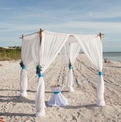 A beautiful beach wedding arch with dendrobium orchids