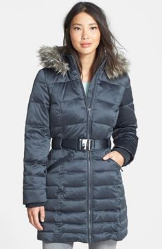 Free shipping and returns on DKNY Faux Fur Trim Belted Hooded Quilted Walking Coat (Regular & Petite) at Nordstrom.com. A ruff of faux fur at the hood adds elegant style and warmth to a quilted walking coat filled with a lightweight blend of down and feathers. Ribbing at the stand collar, belted waist and inset cuffs adds cool, tactile contrast.