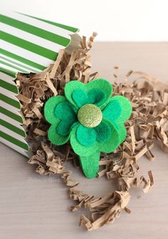 Be pinch proof on St. Patrick's Day by wearing this easy-to-create Four-Leaf Clover Hair Clip.  Get the full tutorial at pitterandglink.com.
