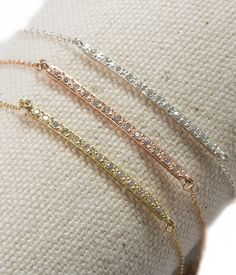 These diamond bracelets are chic without trying.  14K yellow or rose gold…