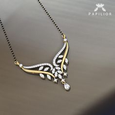 A complete contemporary look of Indian anupom this one is bound to be lapped up by young ladies. Real Gold Jewelry, Gold Jewelry Simple, Gold Jewellery Design, Diamond Mangalsutra, Gold Mangalsutra Designs, Long Pearl Necklaces, Diamond Necklaces, Gold Necklace, Egyptian Jewelry