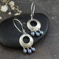 Hammered Sterling Silver Earrings with Purple Freshwater Pearl Dangles. $48.00, via Etsy.