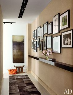 Gallery wall in a corridor of actress Julianna Margulies's Manhattan apartment (via Architectural Digest).