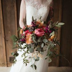 Bold wedding bouquet with pink peony, orange parrot tulips and eucalyptus.  Photo: Ash Carr