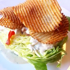 NOLA Restaurant - Bibb Lettuce Wedge, roasted peppers, house-made bacon,gaufrette potato chips & roasted shallot goat cheese dressing. #nolalunch #noladinner