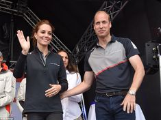 The royal couple waved and smiled for the crowd as they stood on the stage after they watched the racing in Portsmouth, Hampshire, today