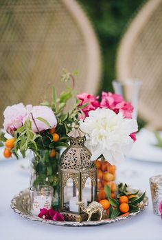 Brides.com: . Colorful kumquats pair perfectly with elegant pink-and-white peonies to make a pretty centerpiece at this bobo-inspired bash.