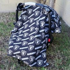 Raiders carseat canopy. Check out this item in my Etsy shop https://www.etsy.com/listing/256613757/nfl-oakland-raiders-carseat-canopy