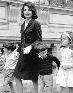 Jackie walking through New York City with her two children Caroline and John and her nephew Anthony Radziwill.