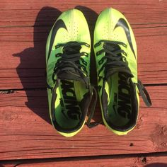 b39ae3c47289 Nike track spikes MENS size 7. WOMENS Size 8-8.5. Originally bought for  $120. Worn but Good condition. Neon yellow w/ gold bottoms. 1/4 inch spikes.