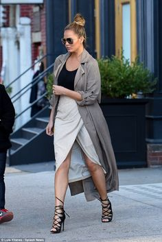 Heel girl! Chrissy Teigen stepped out in a pair of sexy leather high heels for an outing i...