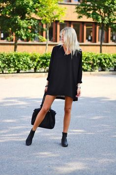 Black boxy dress matched with black accessories