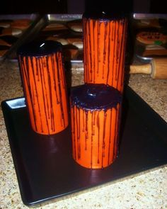 Orange candles with black wax dripped onto the top and down the sides! I love candles!