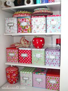 such a fun collection of storage boxes and i love the big red polka dotted…