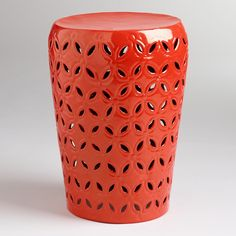 Refresh your outdoor seating arrangement with our drum stool, embellished with a punched pattern around the sides for a global-inspired look. In a vibrant orange hue, it also makes a bold accent table.