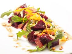 Beet and Citrus Salad with Pinenut Vinaigrette    Beets and citrus are a classic combination. This salad combines grapefruit, orange, roasted beets, and bit of arugula for some peppery kick. Nuts, in this case pine, go great with beets, and a vinaigrette made with sherry vinegar, shallots, walnut oil, and a touch of agave nectar sweetens the whole thing.